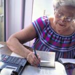 elderly_woman_finances_ss_53463469